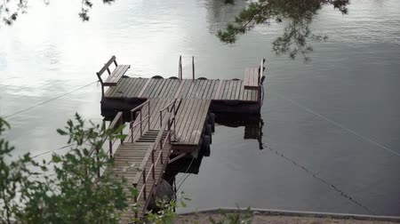 pontão : Pier and wooden boat at the lake at summer day Vídeos