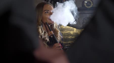 eufória : Hookah smoker. Young woman smoking shisha or hookah in cafe or bar. Resting in shishabar lounge.