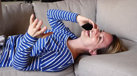woman lay on the couch take some good time with phone