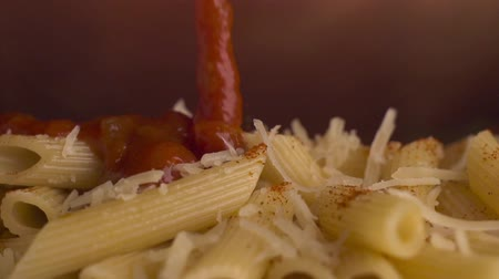 chili : Penne pasta with chili sauce Stock Footage