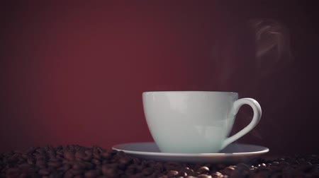 black coffee : steaming coffee with beans