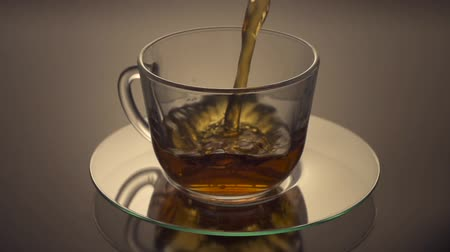 black tea : Tea being poured into glass tea cup