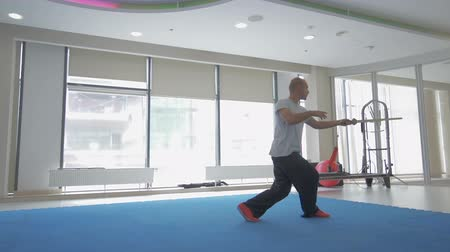 taiji : Young man practising kungfu in gym