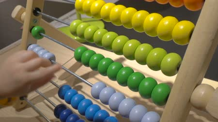 abacus : little boy counts on abacus