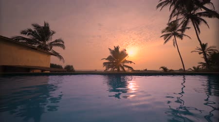 sima : sea beach resort swimming pool with sunset reflection