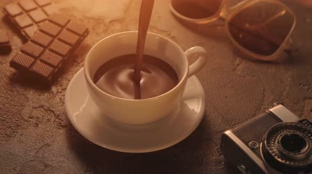 Vintage Film Look: cup of chocolate with camera and retro sunglasses Stok Video