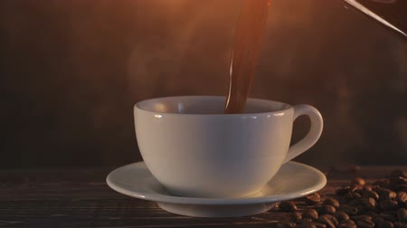 buharlama : steaming coffee on dark brown background