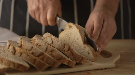 хлеб : Cutting a home made bread