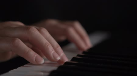 piano parts : Womans hands on the keyboard of the piano closeup Stock Footage