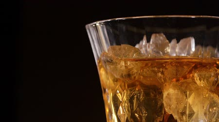 občerstvení : Whiskey with ice on a black background