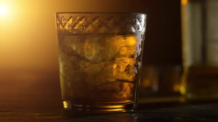 bourbon whisky : Ice cubes in a whiskey