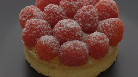 tartlet : Sweet tartlet with raspberries rotating on gray background