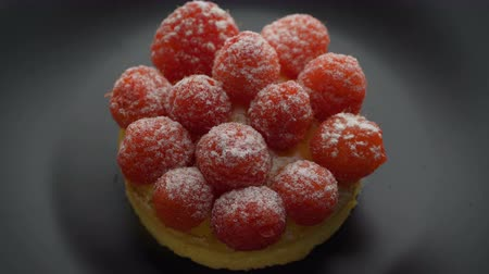 pite : Sweet tartlet with raspberries rotating on gray background