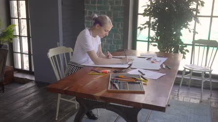 tırnak : Female designer with a pen, designing and sketching new collection Stok Video
