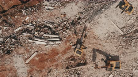 escavadora : Excavators demolishing old factory for new construction project, aerial top view