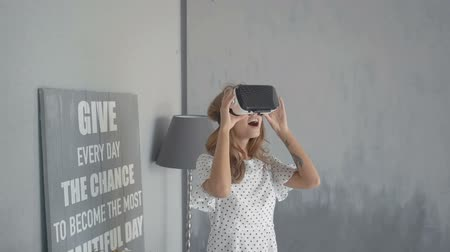 mobile game : beautiful woman enjoy experience vr headset glasses at home