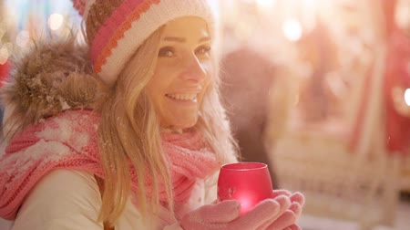 mystik : Beautiful young woman with glowing candle in hands, enjoying Christmas or New Year holidays Dostupné videozáznamy