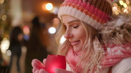 mystik : Beautiful young woman with glowing candle in hands, enjoying Christmas or New Year night Dostupné videozáznamy