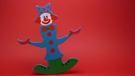 loutka : Funny wooden clown on red background