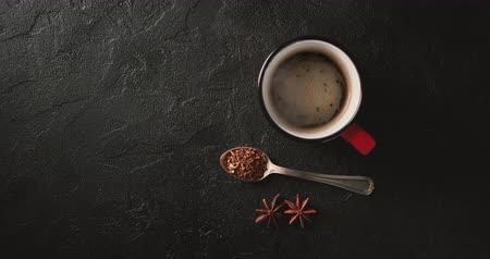 instante : Cinemagrah loop. Steaming coffee cup on dark background. Top view with copy space Stock Footage