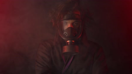 핵 : Apocalypse or armageddon concept. Man is wearing gas mask among poison smoke 무비클립