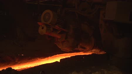 demirli : The flap of the blast furnace is closed and illuminated reflections hot iron