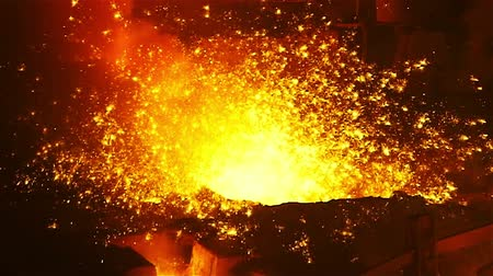metal worker : Molten metal melted in furnace at metallurgical plant Stock Footage