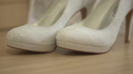 footgear : beautiful white shoes from bride Stock Footage