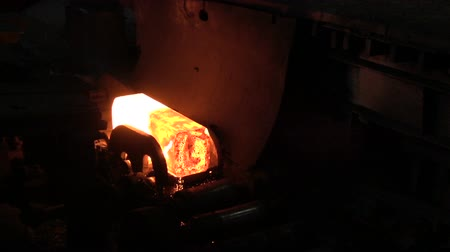 open hearth : The red-hot billet riding on rollers