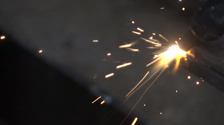 asphalt base : apparatus for welding metal sparks 6 Stock Footage