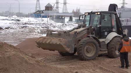 asphalt base : Tractor leveled the hot sand