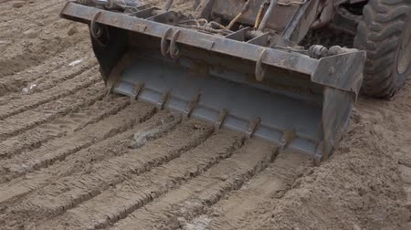 asphalt base : Tractor leveled the hot sand 6 Stock Footage
