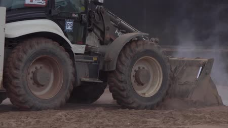 asphalt base : Tractor leveled the hot sand 12