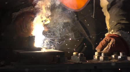 asphalt base : close-up of hands performing welding Stock Footage
