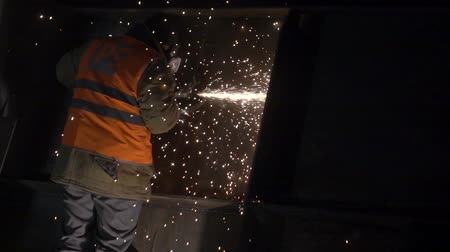 asphalt base : Working man and sparks 2 Stock Footage