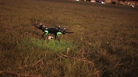 stable fly : Drone takes off from grassy field in evening