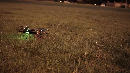 stable fly : Drone trying to take off from grassy field in evening Stock Footage
