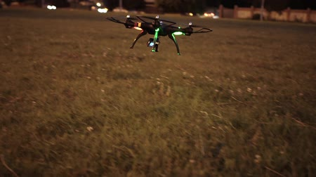 stable fly : Drone with camera trying to take off from grassy field in evening