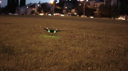 stable fly : Drone with action camera trying to take off from grassy field in evening
