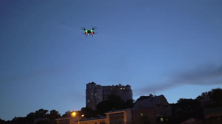 stable fly : Drone flying in the twilight sky Stock Footage