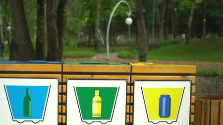 litter box : Colorful recycle waste containers bins for separation of garbage in park Stock Footage