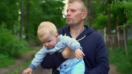 fearless : Happy father and son in park