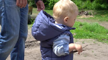 fearless : Happy baby boy making first steps in park