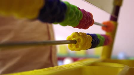 abacus : Baby counting on abacus playing in daycare with financial tools, elementary education Close up Stock Footage
