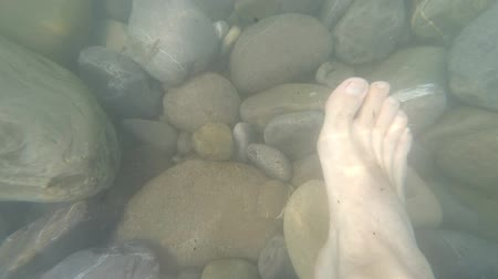 POV Legs on pebble bottom of the ocean Vacation Summertime Wideo