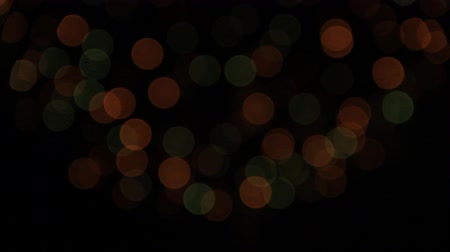 glow pyrotechnics : Beautiful bokeh of slow red, white and green fireworks at night sky holiday background Blurry firework sparkler Stock Footage