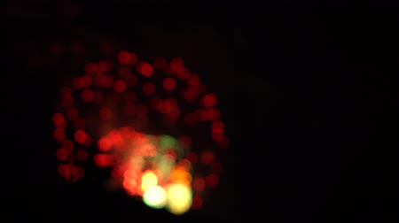 Fireworks background with bokeh and optical effect. Red and green circle