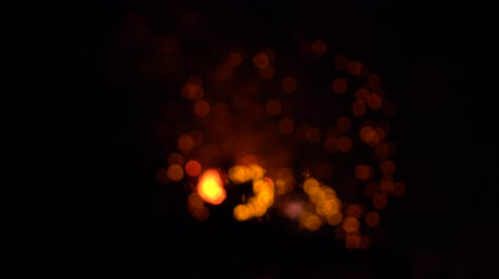 Red and gold circle fireworks with bokeh and optical effect. Holiday background