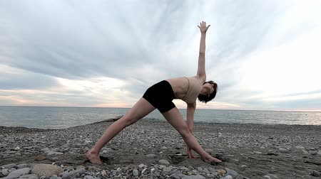 Caucasian sportive woman practicing yoga at seashore of tropic ocean. Healthy lifestyle. Fitness concept. Wideo