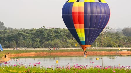 rai : Balloons float across the sky at the Chiang Rai Balloon Festival in Thailand.